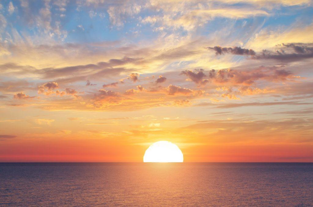 Big sun and sea sunset background